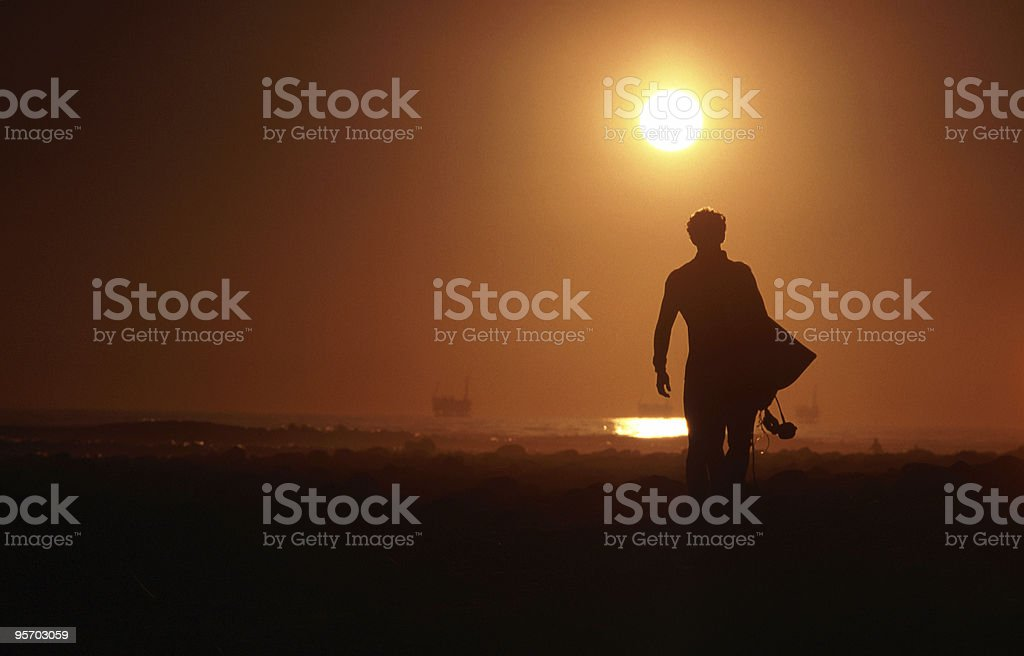 Silhouette of Surfer stock photo