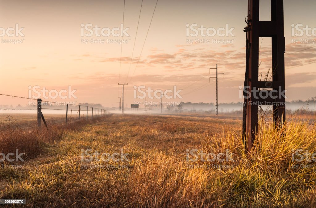 Silhouette of telephone pylons in the outback at dawn. Darwin, Australia stock photo