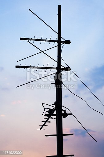 TV and communication aerials on roof of residential house