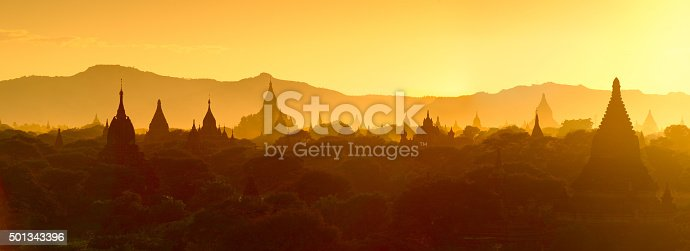 Silhouette of temples and stupa Bagan in Myanmar, tourists watching sunset over ancient city