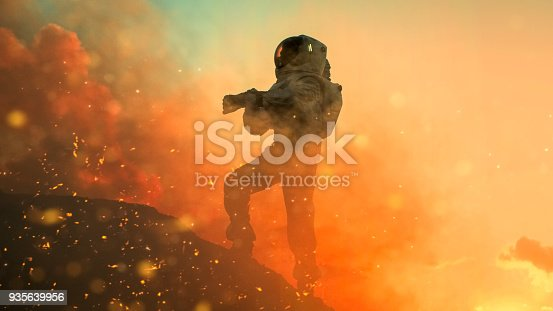 istock Silhouette of the Astronaut Takes Air Tests on the Rocky Mountain of the Alien Planet During Fire Storm. First Manned Mission on Venus. Space Exploration, Colonization. 935639956