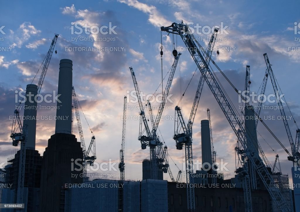 London, UK - June 03, 2018: Silhouette of the Battersea Power Station and Construction Cranes stock photo