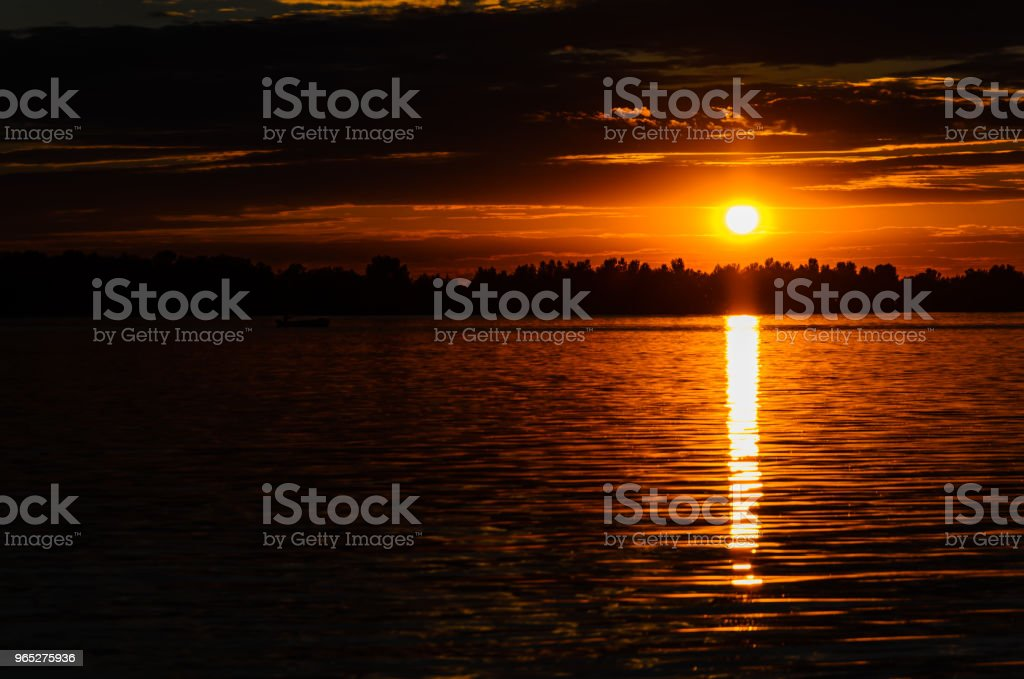 Silhouette of the boat on river Dnieper at sunset zbiór zdjęć royalty-free