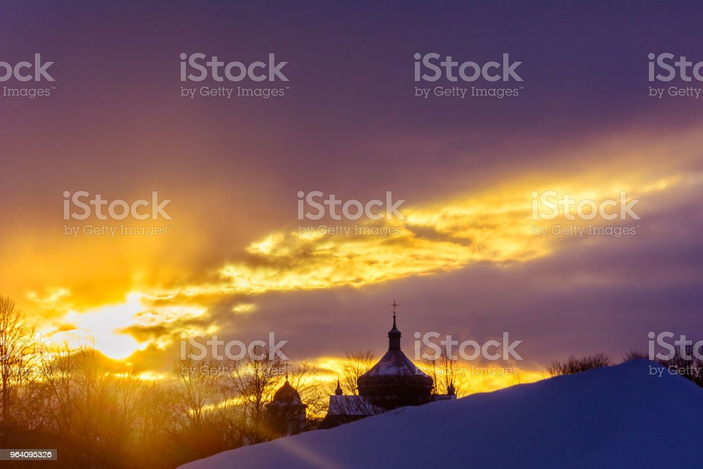 Silhouette of the church in the Ukrainian village at sunset in winter - Royalty-free Architecture Stock Photo