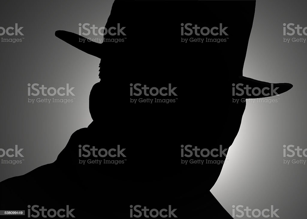 silhouette of the detectives stock photo