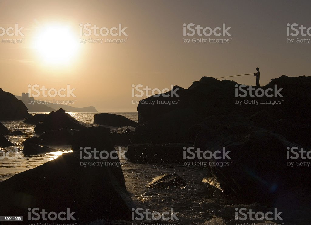 Silhouette of the fisherman royalty free stockfoto