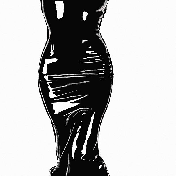 Silhouette of the girl in a leather dress stock photo