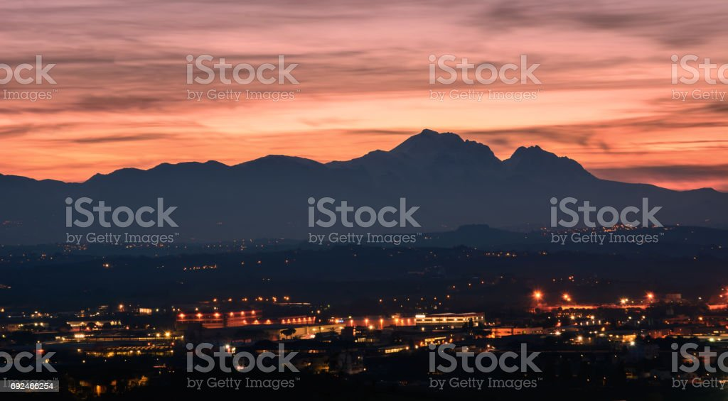 Silhouette of the Gran Sasso in Abruzzo at sunset resembling the profile of the Sleeping Beauty stock photo