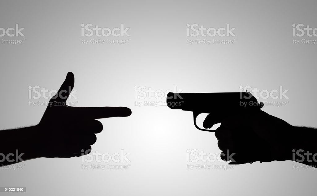 silhouette of the gun stock photo