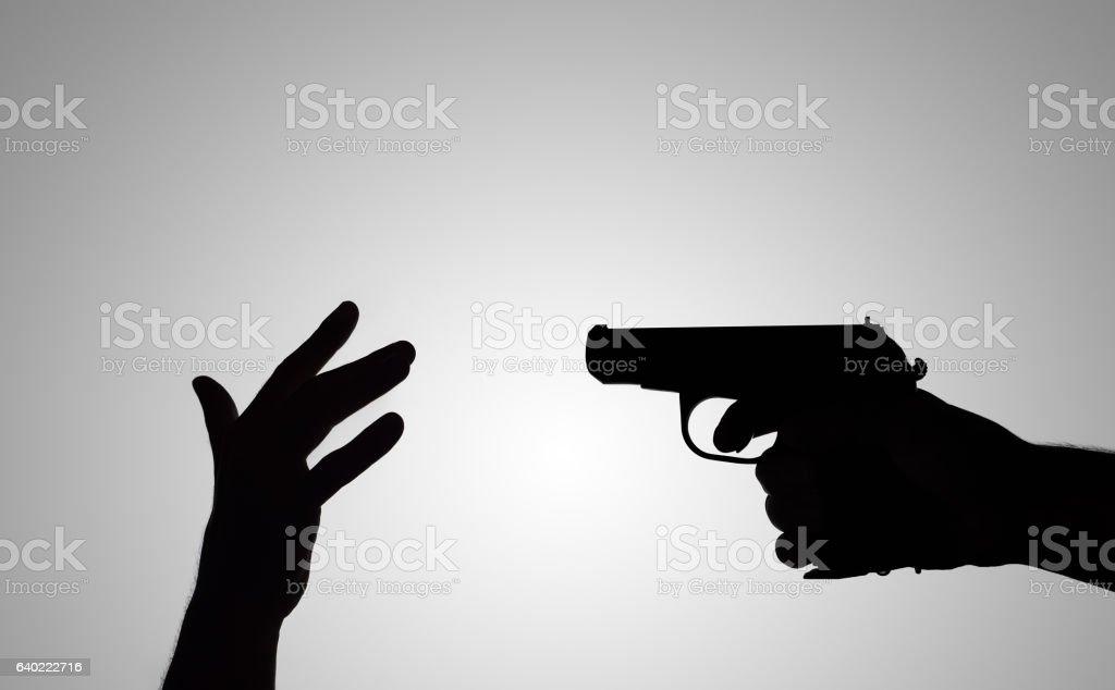 silhouette of the gun stock photo