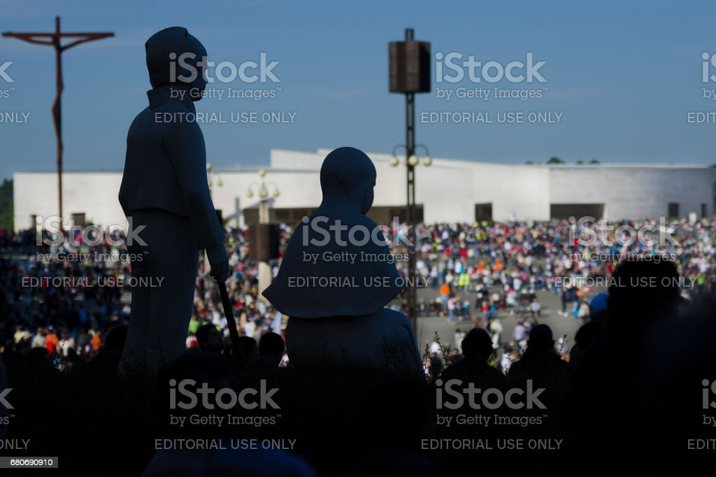 Silhouette of the images of the litle shepherds at the Sanctuary of Fatima during the celebrations of the apparition of the Virgin Mary in Fatima, Portugal. stock photo