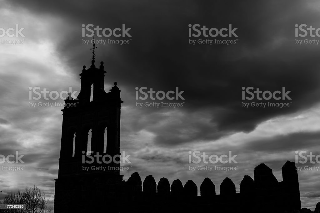 Silhouette of the medieval Wall of Avila stock photo
