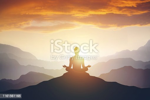 Silhouette of the meditaion man on the mountain. Leadership Concept