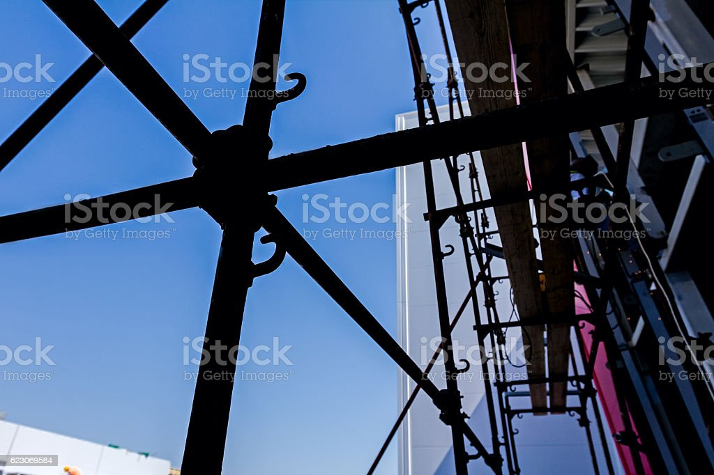 Silhouette of the scaffold joint with back light stock photo