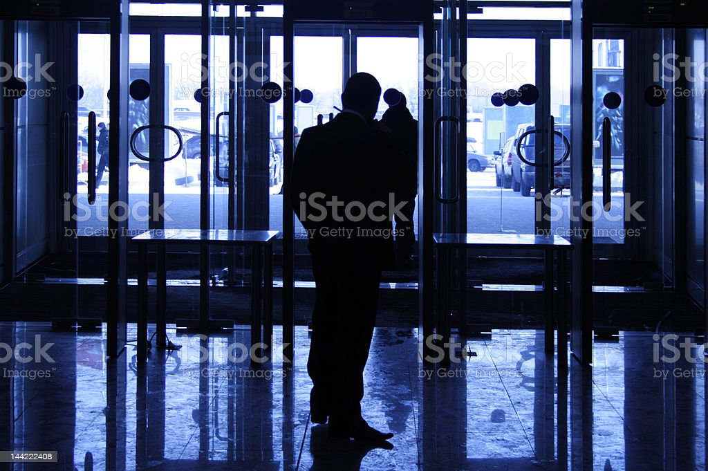 silhouette of the security guard stock photo