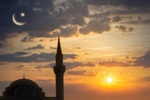 silhouette of the sehitlik mosque in berlin at the evening silhouette of the sehitlik mosque in berlin at the evening minaret stock pictures, royalty-free photos & images
