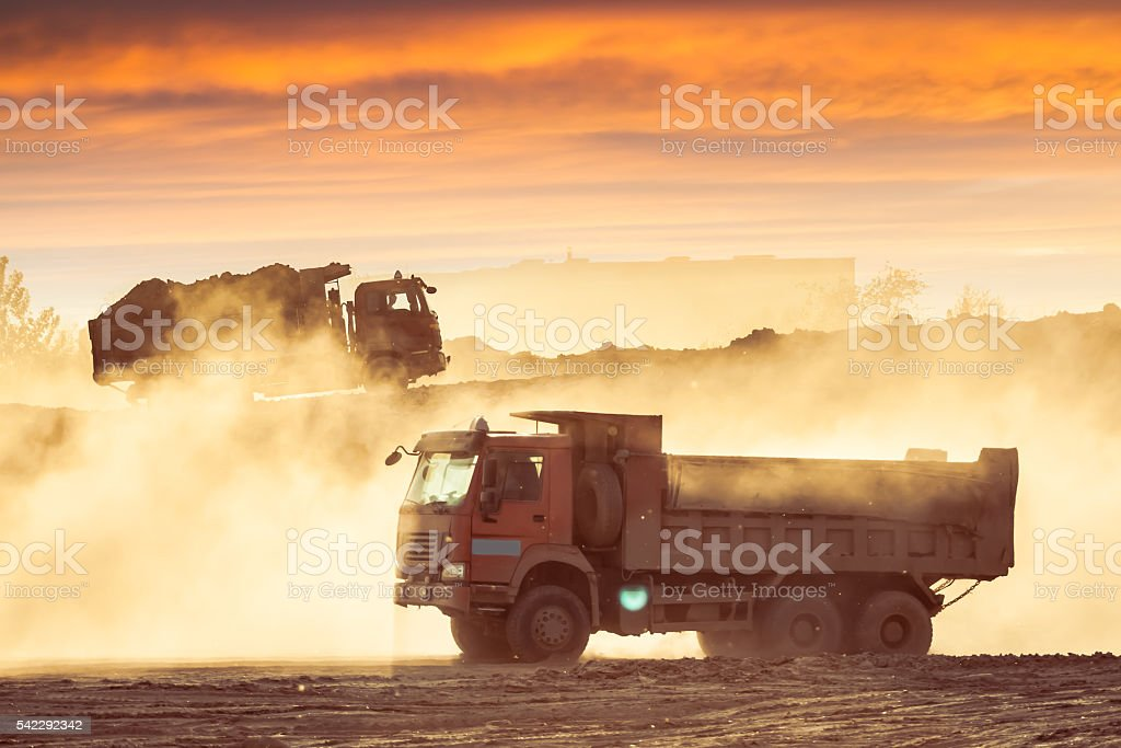 Silhouette of the truck in the building site stock photo