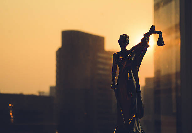 Silhouette of Themis with building background stock photo