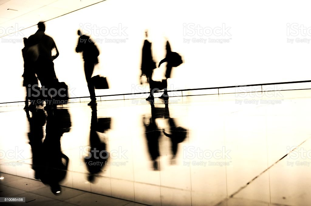 Silhouette of traveling people stock photo