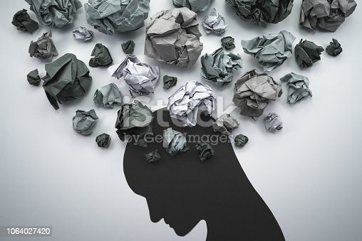 istock Silhouette of troubled person head. 1064027420