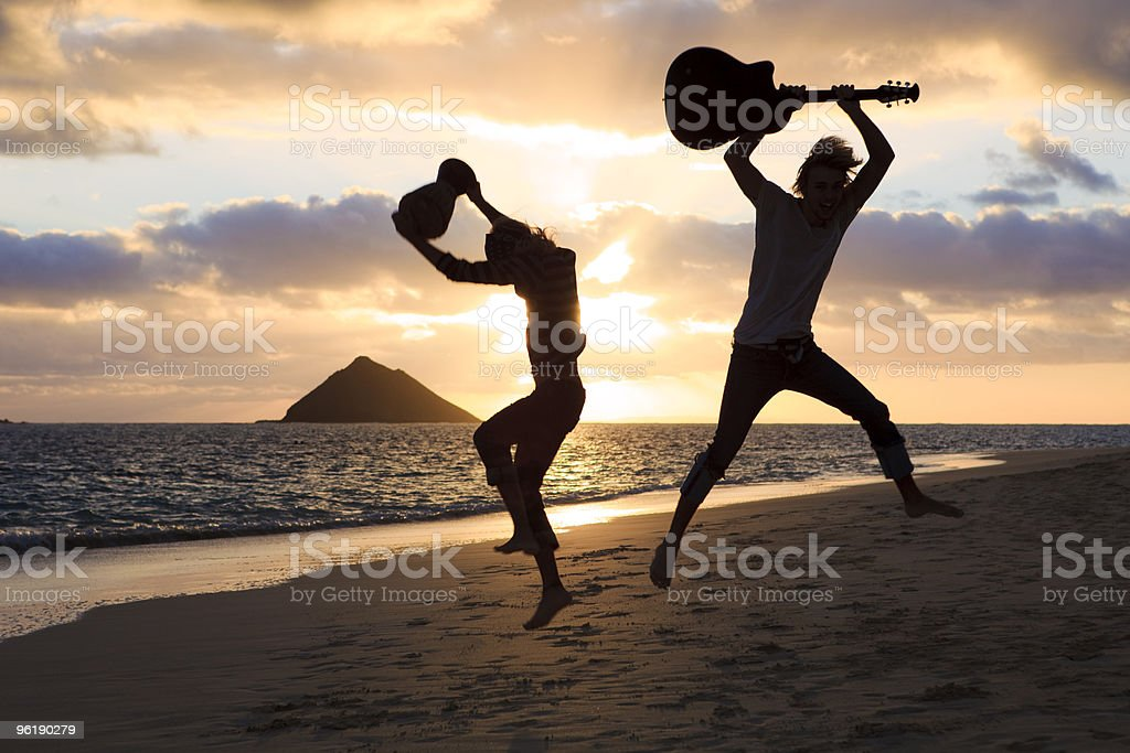 silhouette of twin brothers with drum and guitar stock photo