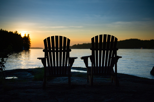 Silhouette Of Two Adirondack Chairs Stock Photo - Download ...