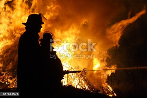 Firefighter extinguish a fire at night