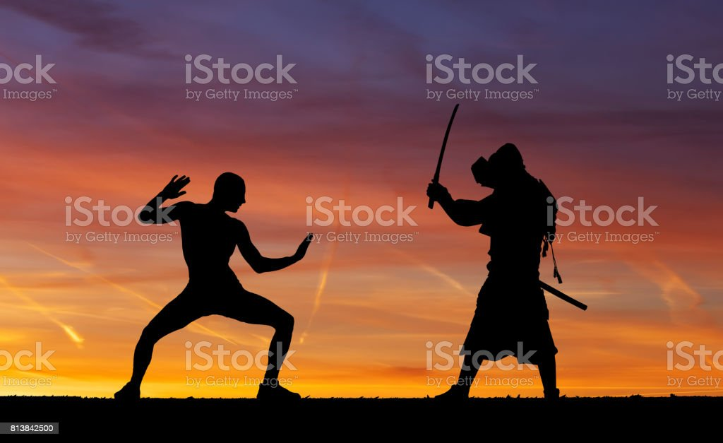 Silhouette of two samurais in duel. Picture with two samurais and sunset sky stock photo