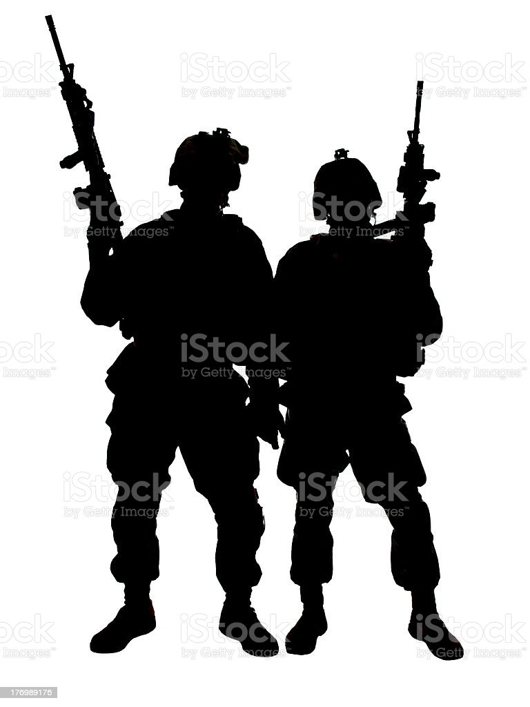 A silhouette of two US Marine soldiers stock photo