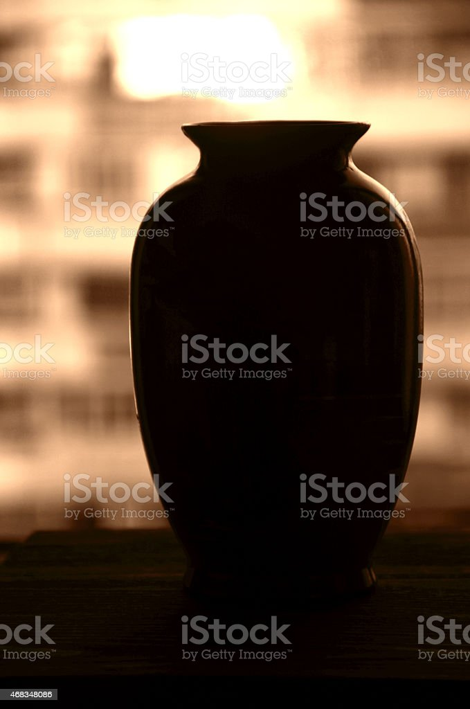 Silhouette of vase. Sepia tones royalty-free stock photo