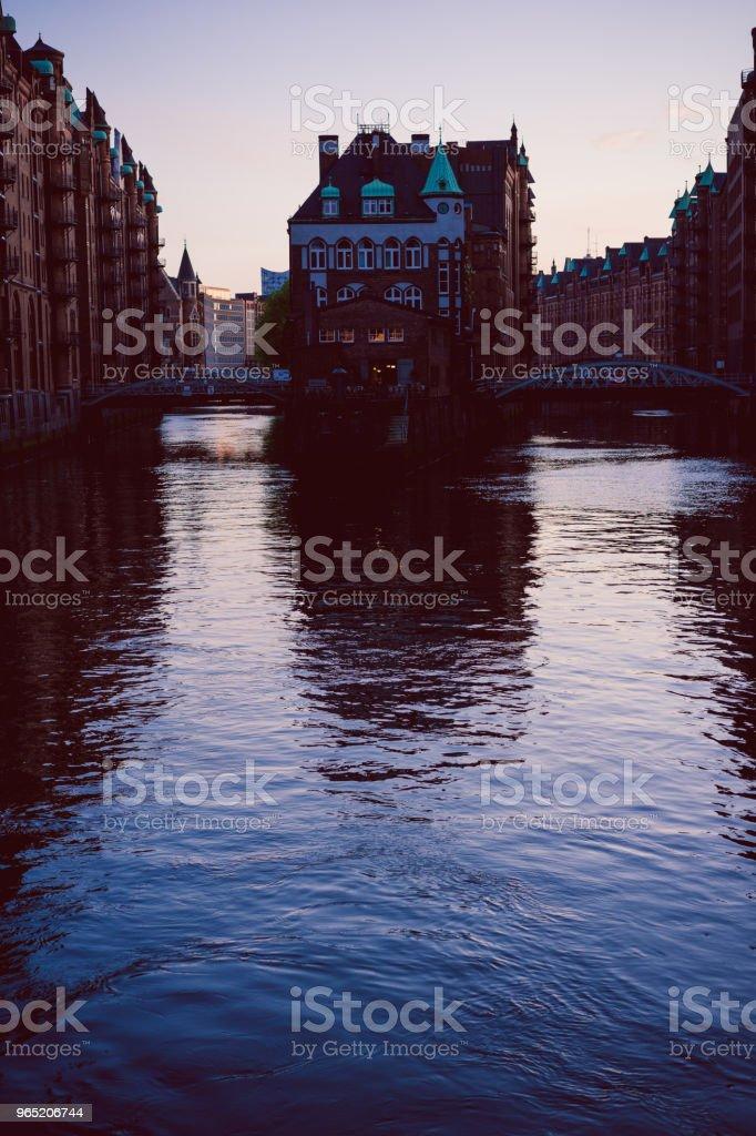 Silhouette of water castle in old Speicherstadt or Warehouse district in evening sun light, Hamburg, Germany zbiór zdjęć royalty-free