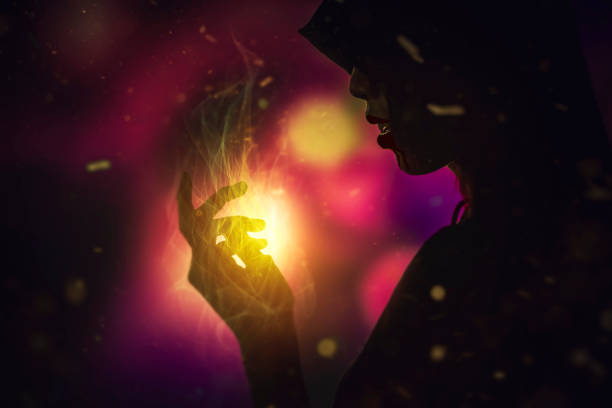 Silhouette of Witch cast the spell. Halloween concept. stock photo