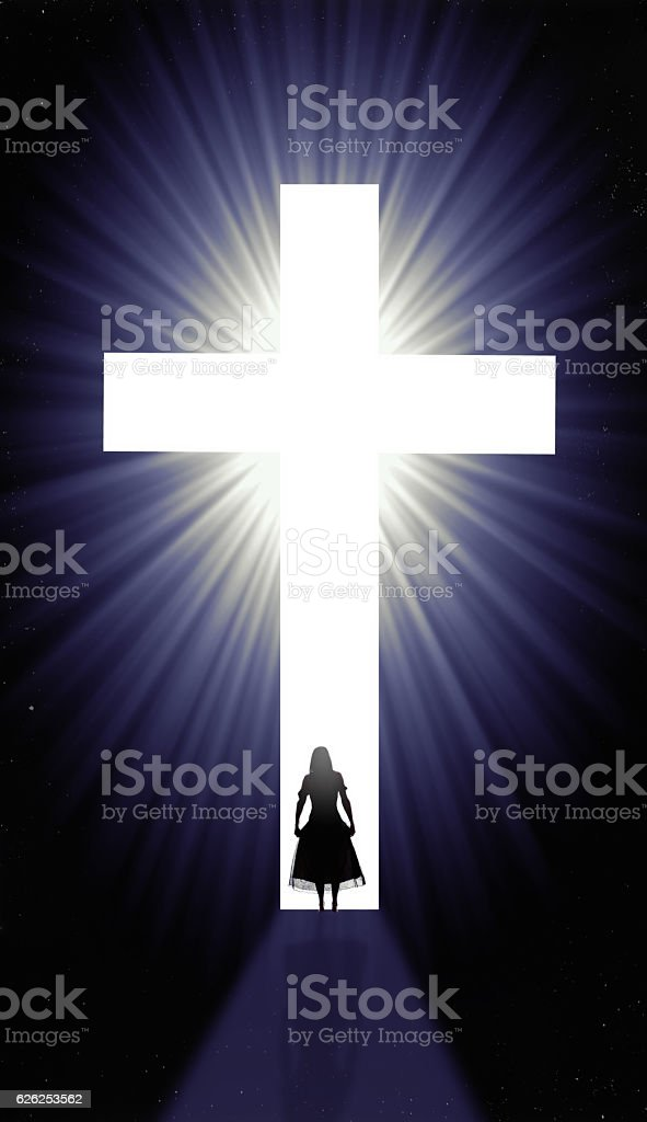 Silhouette Of Woman At Christian Cross stock photo