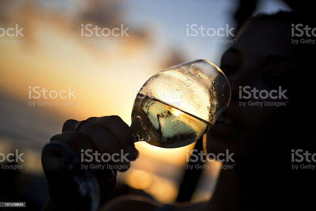 Silhouette of woman drinking wine royalty-free stock photo