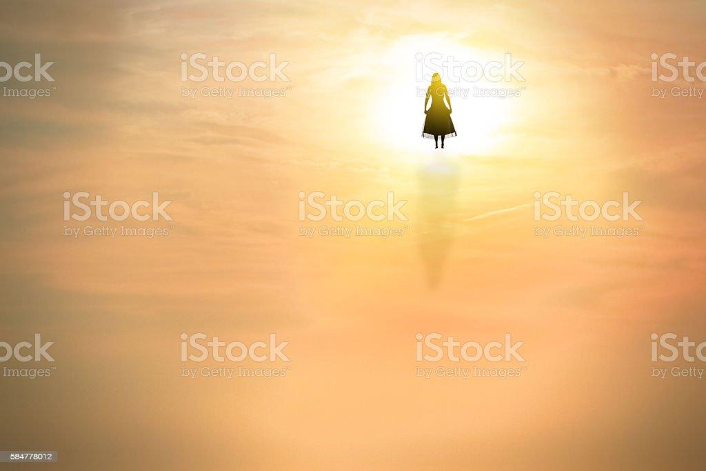 Silhouette Of Woman Entering Eternal Light stock photo
