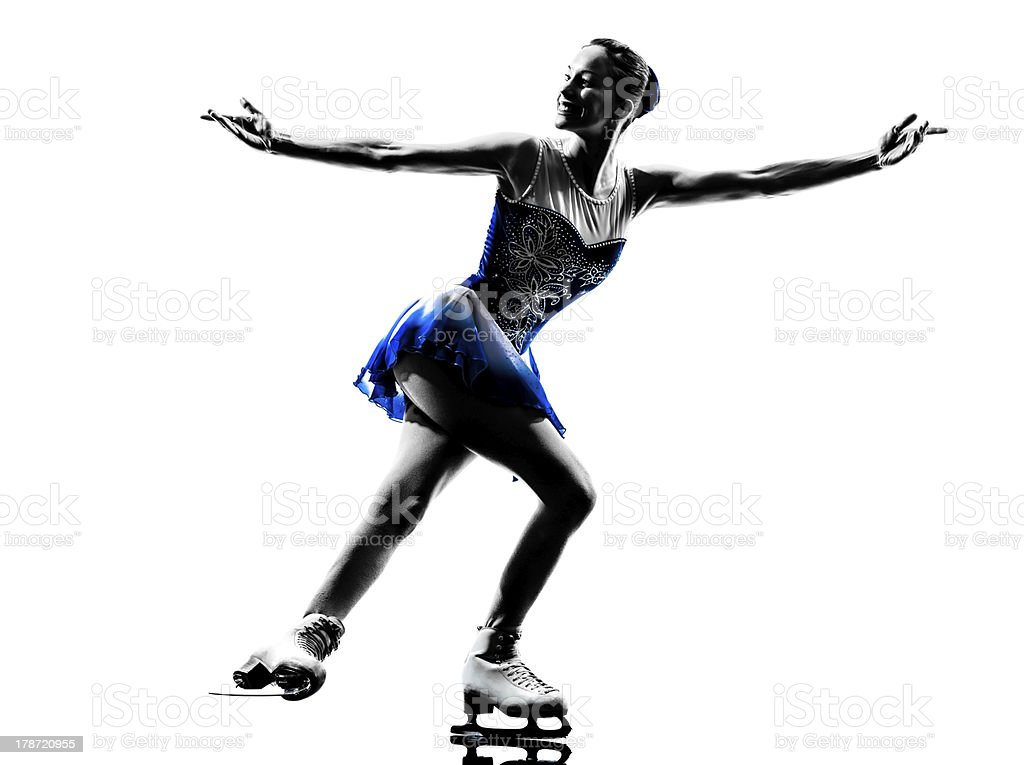 Silhouette of woman ice skater skating on white background stock photo