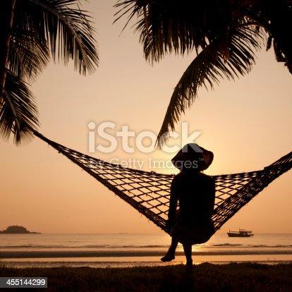 817409212 istock photo silhouette of woman in hammock 455144299