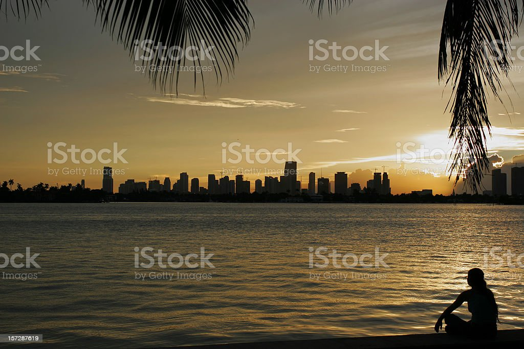 Silhouette of Woman on Beach in Miami royalty-free stock photo