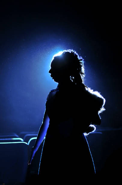 silhouette of woman on blue background - opera stock photos and pictures