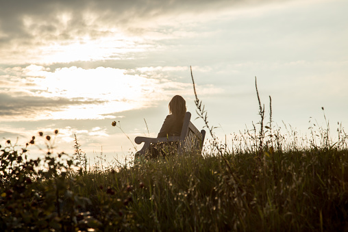 istock Silhouette of Woman on the hill 465662506