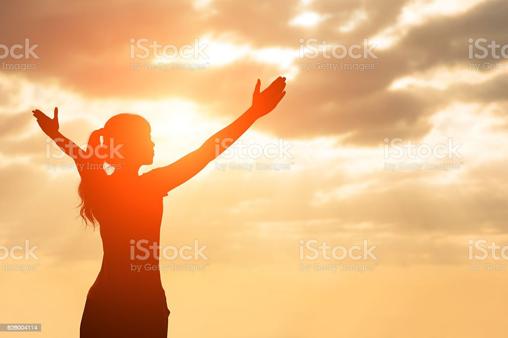 silhouette of woman pray stock photo