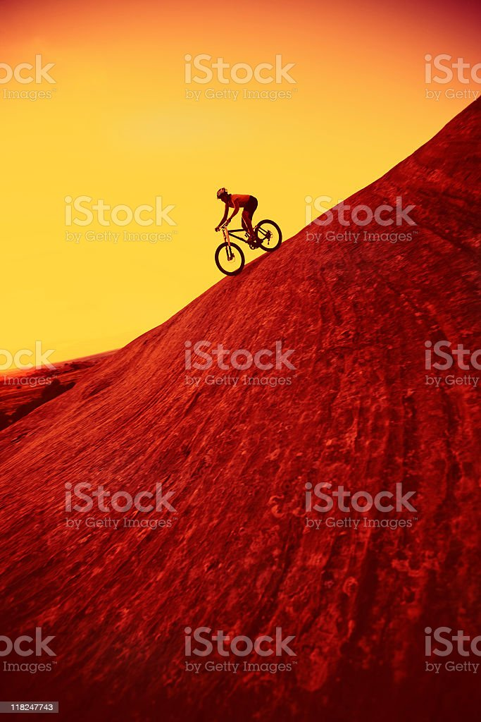 Silhouette Of Woman Riding Downhill On Bike In Utah royalty-free stock photo