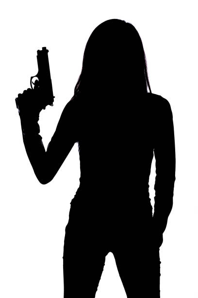 silhouette of woman with handgun on white background - female spy stock photos and pictures