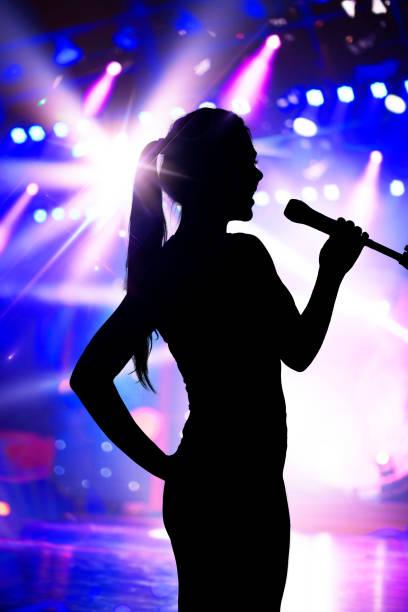 Closeup of Young Man Singing Into Microphone Stock Photos