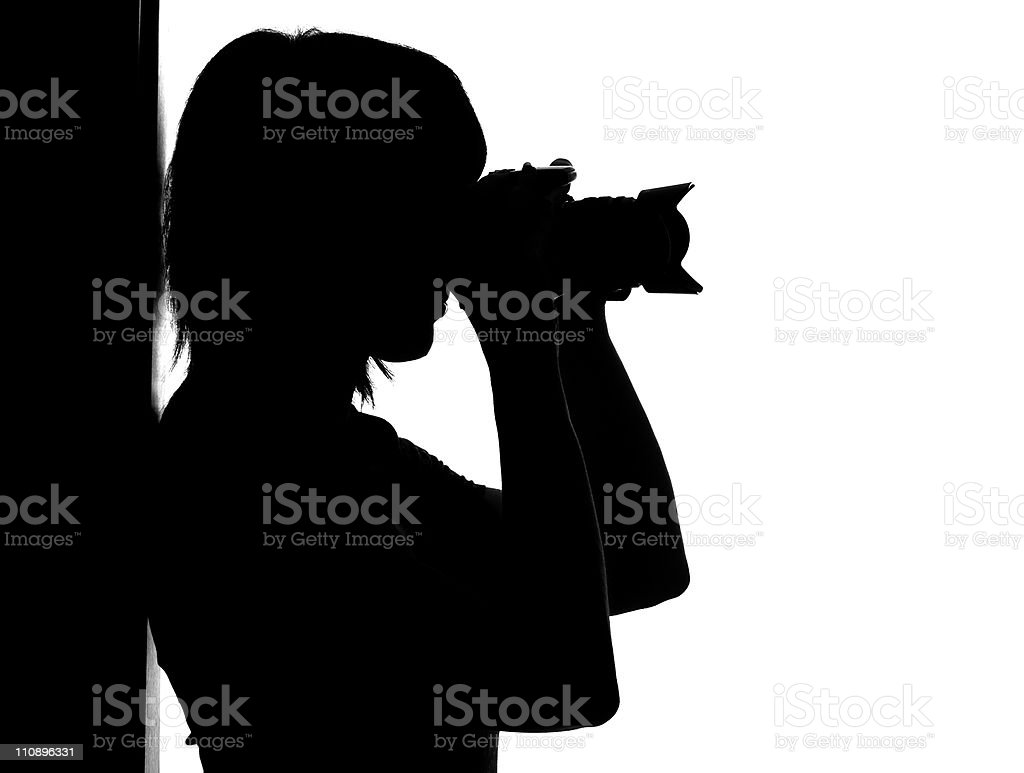Silhouette of woman with photo camera royalty-free stock photo