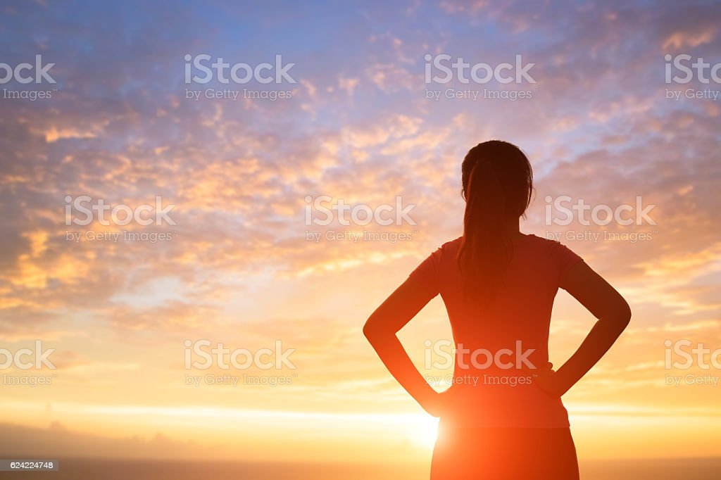 silhouette of woman with sunlight stock photo