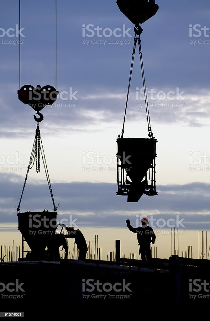Silhouette of workers at a construction site stock photo
