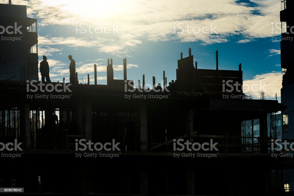 Silhouette of workers stock photo