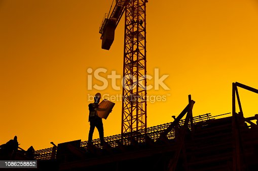 istock Silhouette of working man standing with his planning paper 1086258852