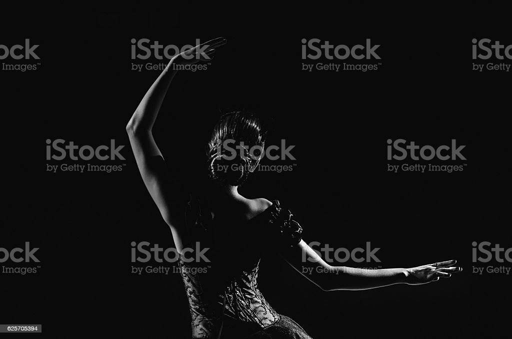Silhouette of young ballet dancer standing back to camera stock photo